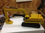 Cat 245 excavator yellow