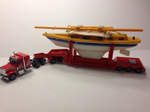 Peterbilt with lowboy and boat load - Click Image to Close